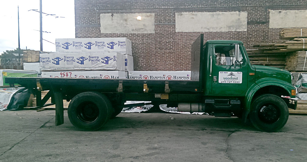 profile view of our new army green flatbed delivery truck